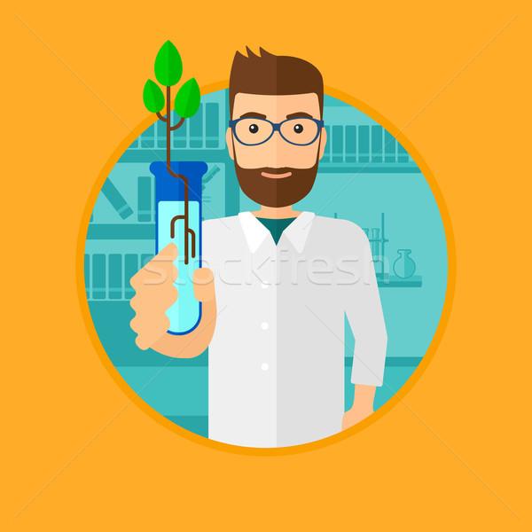 Tudós kémcső tart fiatal növény hajtás Stock fotó © RAStudio