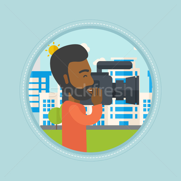 Cameraman with video camera vector illustration. Stock photo © RAStudio