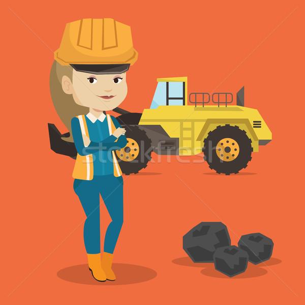 Miner with a big excavator on background. Stock photo © RAStudio
