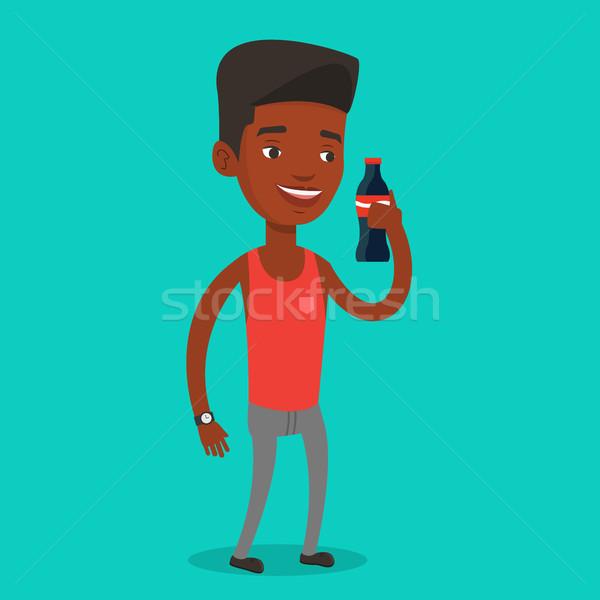 Młody człowiek pitnej sody człowiek świeże Zdjęcia stock © RAStudio