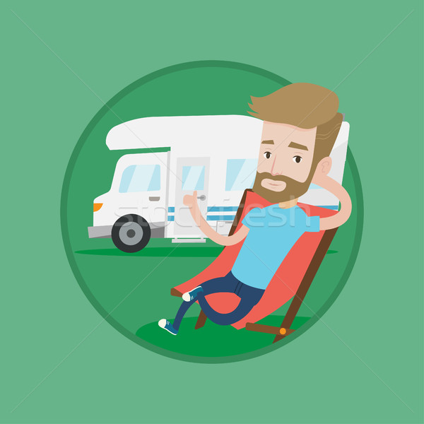 Man sitting in chair in front of camper van. Stock photo © RAStudio