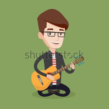 Adam oynama akustik gitar müzisyen oturma gitar Stok fotoğraf © RAStudio