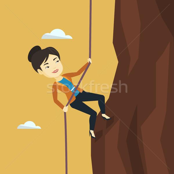 Business woman climbing on the mountain. Stock photo © RAStudio