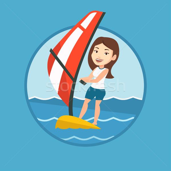 Young woman windsurfing in the sea. Stock photo © RAStudio
