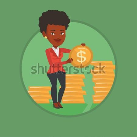 Wealthy businessman holding dollar coin. Stock photo © RAStudio