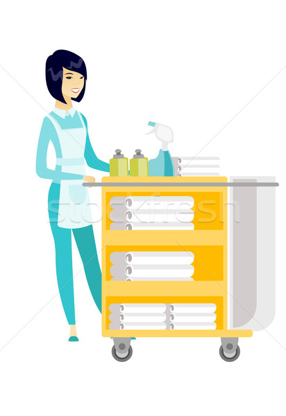 Chambermaid pushing cart with bed clothes. Stock photo © RAStudio
