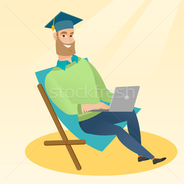 Graduate sitting in chaise lounge with laptop. Stock photo © RAStudio