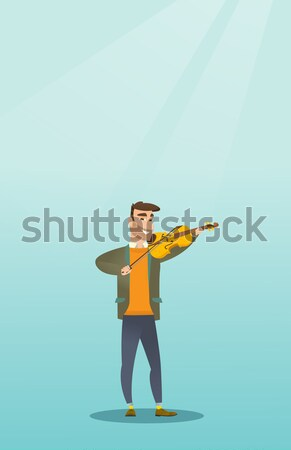 Adult hunter holding a hunting rifle. Stock photo © RAStudio