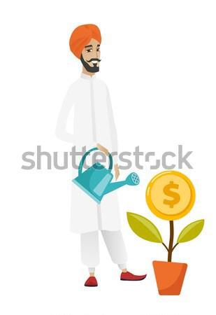 üzletember tart pénz táska mutat széf Stock fotó © RAStudio
