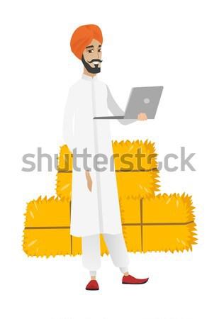 Young muslim traveler man in inflatable ring. Stock photo © RAStudio
