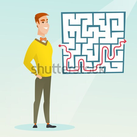 Businessman looking at labyrinth with solution. Stock photo © RAStudio