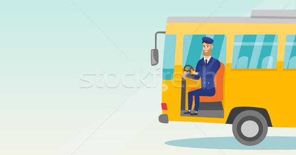 Bus driver seduta volante giovani Foto d'archivio © RAStudio