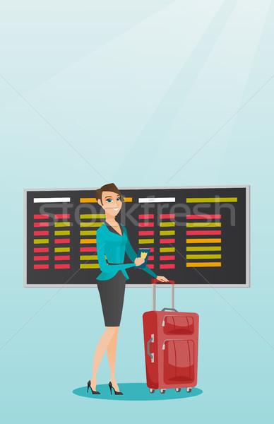 Caucasian airplane passenger holding passport. Stock photo © RAStudio