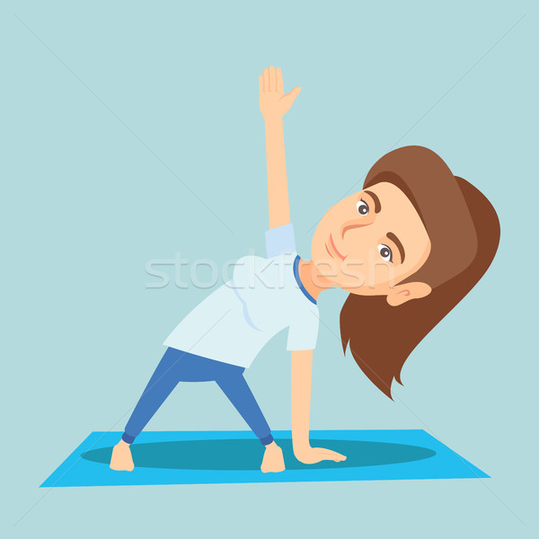 Kaukasisch vrouw oefenen yoga driehoek pose Stockfoto © RAStudio