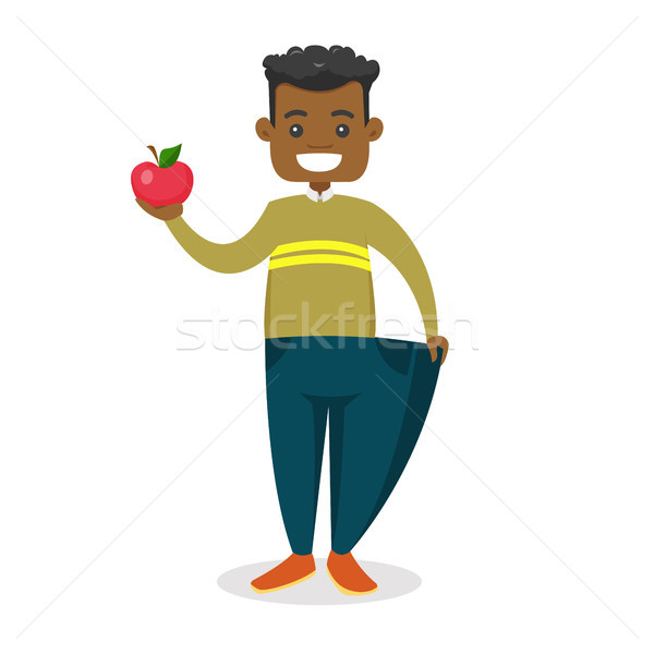 Slim man in pants showing the results of diet. Stock photo © RAStudio