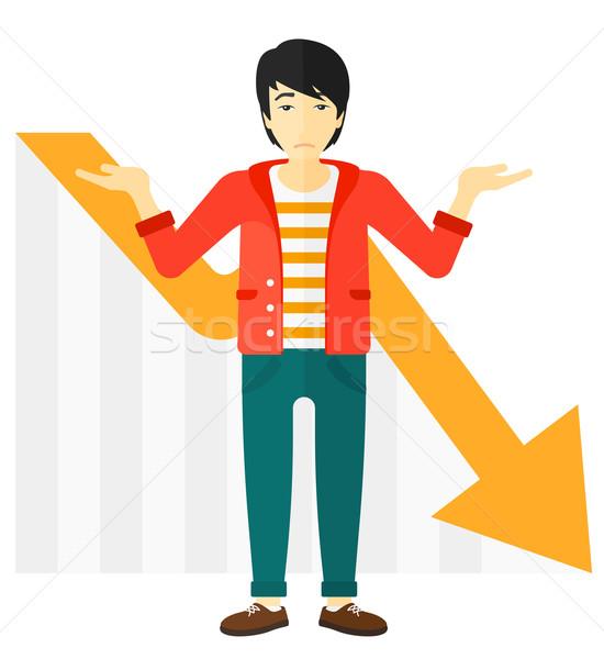 Man with declining chart. Stock photo © RAStudio