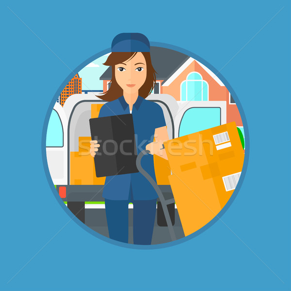 Delivery woman with cardboard boxes. Stock photo © RAStudio