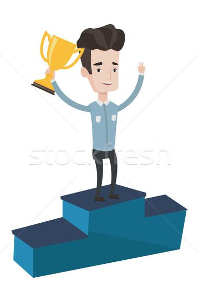 Businessman proud of his business award. Stock photo © RAStudio