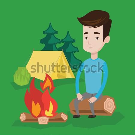 Adam oturma kamp ateşi kamp seyahat genç Stok fotoğraf © RAStudio