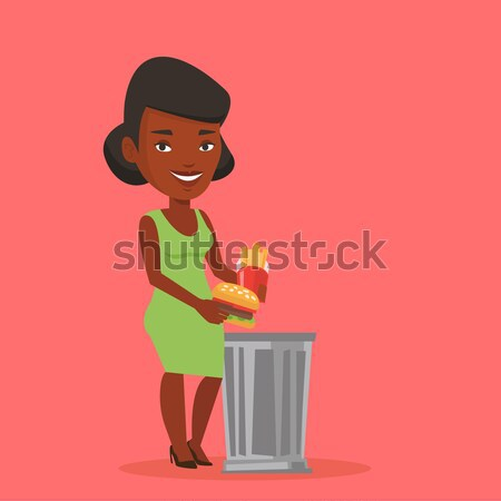 Nő dob egészségtelen étel szemét tároló eszik Stock fotó © RAStudio