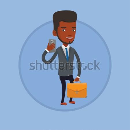 Businessman checking boxes in warehouse. Stock photo © RAStudio