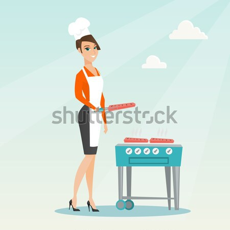 Traveler woman cooking steak on barbecue grill. Stock photo © RAStudio
