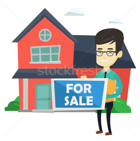 Young asian realtor offering house. Stock photo © RAStudio