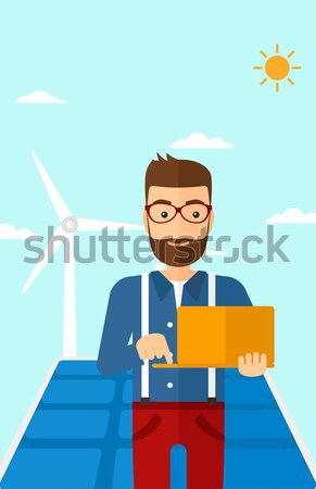 Man working with model wind turbines on the table. Stock photo © RAStudio