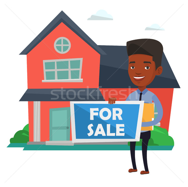 Young african-american realtor offering house. Stock photo © RAStudio