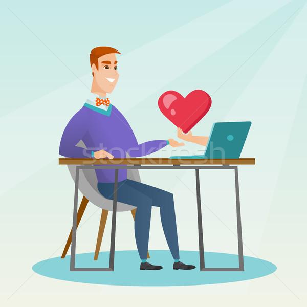 Młody człowiek za pomocą laptopa online dating człowiek Zdjęcia stock © RAStudio