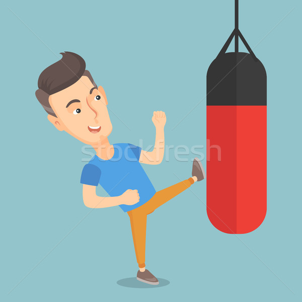 Man exercising with a punching bag. Stock photo © RAStudio