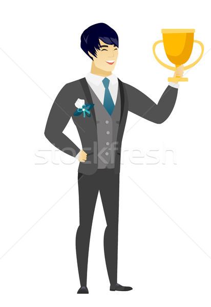 Asian groom holding a trophy. Stock photo © RAStudio