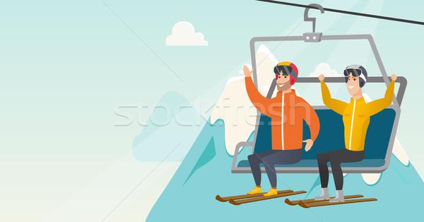 Two caucasian skiers using cableway at ski resort. Stock photo © RAStudio