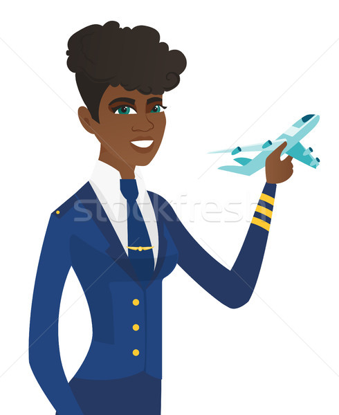 Young african stewardess with model of airplane. Stock photo © RAStudio