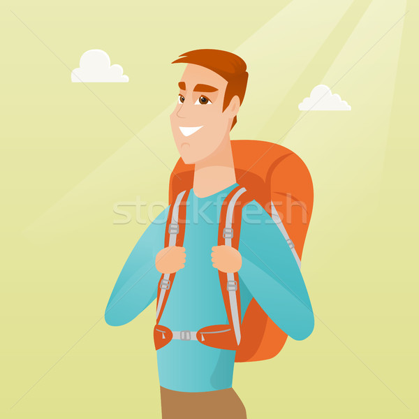 Young caucasian traveler man with a backpack. Stock photo © RAStudio
