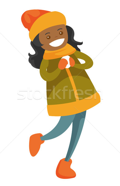 African-american woman playing snowball fight. Stock photo © RAStudio