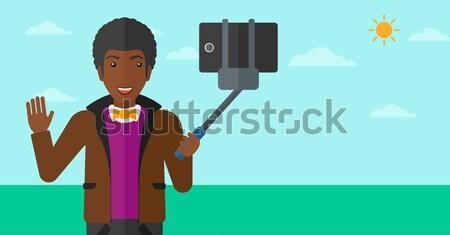 Photographer with camera in the photo studio. Stock photo © RAStudio