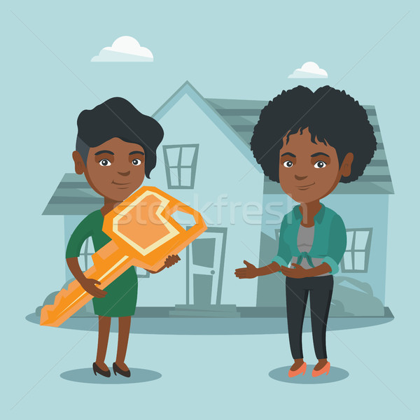 Real estate agent giving key to a new house owner. Stock photo © RAStudio