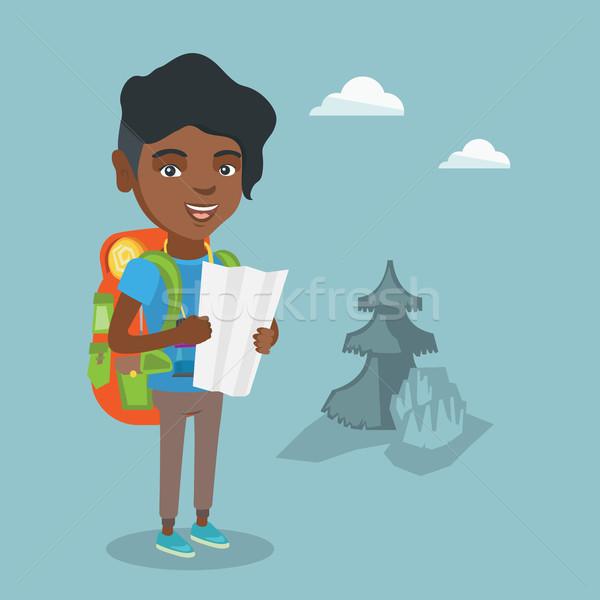 Genç gezgin bakıyor harita kadın sırt çantası Stok fotoğraf © RAStudio