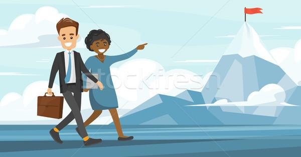 Business multiethnic people achieving their business goal. Stock photo © RAStudio