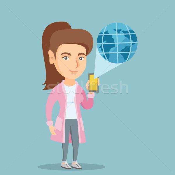 Internationale technologie communicatie jonge kaukasisch vrouw Stockfoto © RAStudio