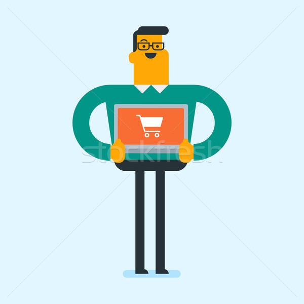 Młodych biały człowiek zakupy online Zdjęcia stock © RAStudio