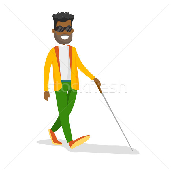 Young african-american blind man with a stick. Stock photo © RAStudio
