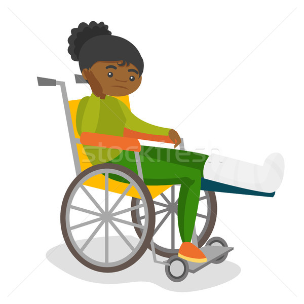 Woman with broken leg sitting in a wheelchair. Stock photo © RAStudio