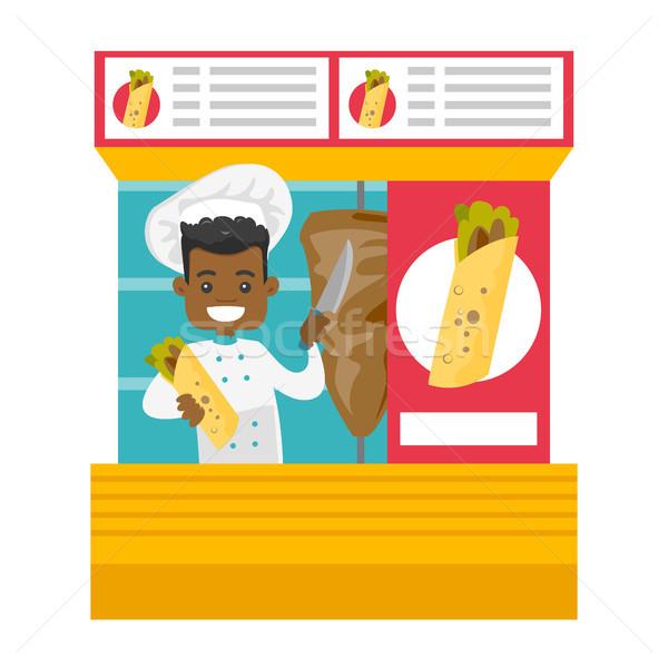 African-american chef preparing shaurma in a kiosk Stock photo © RAStudio