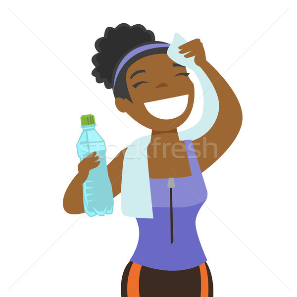 African sportswoman wiping sweat with a towel. Stock photo © RAStudio