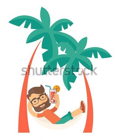 Jonge man strand ontspannen drinken cocktail jonge Stockfoto © RAStudio