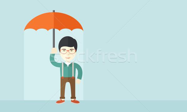 ストックフォト: 成功した · 男 · 傘 · ビジネスマン · 立って · 保護