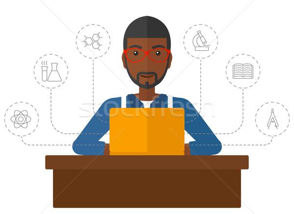 Man studying with laptop. Stock photo © RAStudio