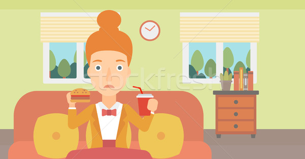 Woman eating hamburger.  Stock photo © RAStudio